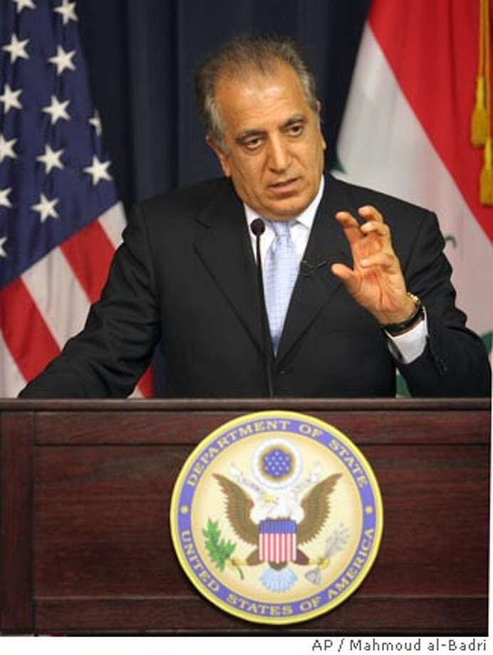 The departing U.S. ambassador to Iraq Zalmay Khalilzad gestures during a press conference in the heavily fortified Green Zone in Baghdad Monday, March 26, 2007. Zalmay Khalilzad, who is leaving his post after 21 months that had seen a massive increase in violence in Baghdad overall, declared that insurgent and militia attacks had decreased by 25 percent in the six weeks since the start of U.S.-Iraqi security plan on Feb. 14. (AP Photo/Mahmoud al-Badri, Pool) Photo: MAHMOUD AL-BADRI