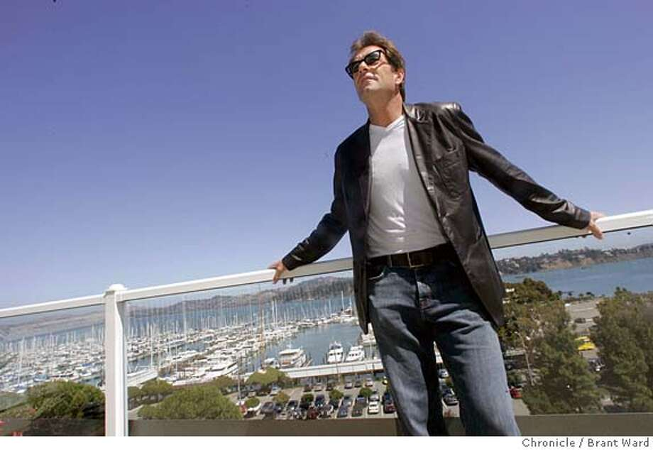 lewis591_ward.jpg  On a balcony at the Casa Madrone hotel, Huey Lewis talked about his plans...the Sausalito harbor is in background.  Huey Lewis, the force behind the band Huey Lewis and the News was back in the Bay Area recently. He now makes his home in Montana. He stopped by the famous Casa Madrone hotel on Bridgeway to have lunch. Brant Ward 9/6/05 Photo: Brant Ward