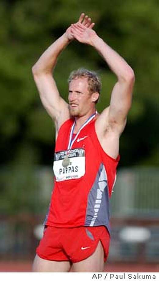 Tom Pappas waves from the victory stand after winning the decathlon with 8,784 points in the U.S. track and field championships, Sunday, June 22, 2003, in Stanford, Calif. (AP Photo/Paul Sakuma) Photo: PAUL SAKUMA