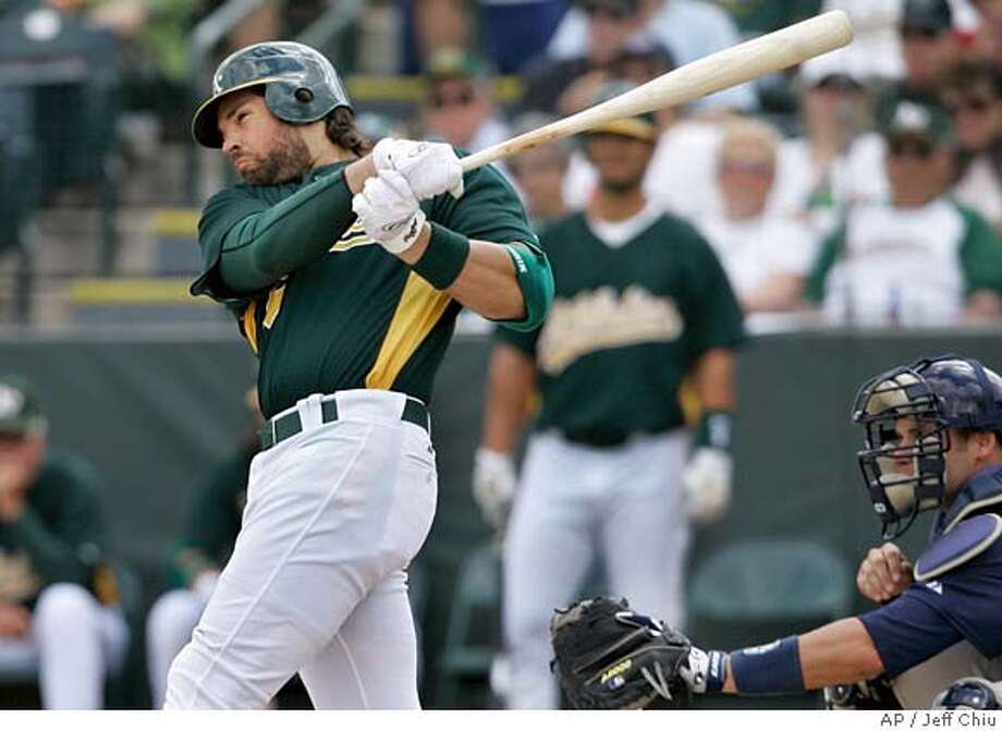 Oakland Athletics' Mike Piazza swings on his three-run home run off of San Diego Padres' Justin Germano in the first inning of a spring training baseball game in Phoenix, Ariz., Friday, March 23, 2007. (AP Photo/Jeff Chiu) Photo: Jeff Chiu