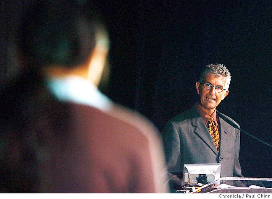 KCBS co-anchor Stan Bunger (right) pronounces a word to spell for a contestant at the Chronicle Spelling Bee in San Francisco, Calif. on Saturday, March 24, 2007. The winner advances to the national finals in Washington D.C. in May.  PAUL CHINN/The Chronicle  **Stan Bunger Photo: PAUL CHINN