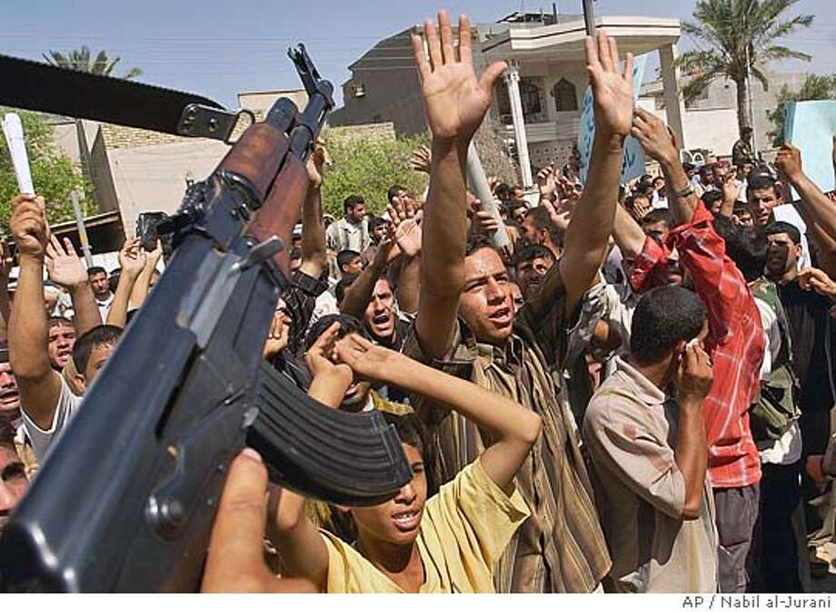 Iraqis protest in Basra, Iraq, Wednesday Sept. 21 2005, demanding an apology for Monday's attack by British forces on the jail where two British nationals were captive. British armored vehicles broke down the walls of the central jail in Basra Monday and freed two British soldiers, allegedly undercover commandos arrested for shooting two Iraqi policemen, witnesses said.(AP Photo/Nabil al-Jurani) Photo: NABIL AL-JURANI