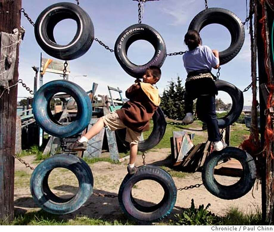 Angel Hernandez (left) and Sierra Thomas, both from Richmond, climb on old tires at Adventure Playground in Berkeley, Calif. on Saturday, March 10, 2007. Adventure Playground is a unique location where children can play on structures that they actually create and construct using tools provided to them. The playground�s been around since 1979 but the concept began after WW II in Europe. At the Berkeley park, countless pieces of scrap wood, tires, rope and other material is donated and used again-and-again by the kids to construct and dismantle slides, swings and climbing structures.  PAUL CHINN/The Chronicle  **Angel Hernandez, Sierra Thomas MANDATORY CREDIT FOR PHOTOGRAPHER AND S.F. CHRONICLE/NO SALES - MAGS OUT Photo: PAUL CHINN