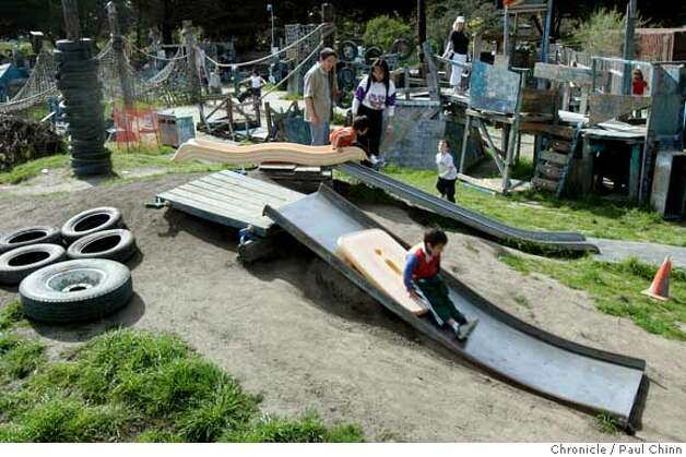 Children play on structures they build and dismantle using recycled wood and materials at Adventure Playground in Berkeley, Calif. on Saturday, March 10, 2007. Adventure Playground is a unique location where children can play on structures that they actually create and construct using tools provided to them. The playground�s been around since 1979 but the concept began after WW II in Europe. At the Berkeley park, countless pieces of scrap wood, tires, rope and other material is donated and used again-and-again by the kids to construct and dismantle slides, swings and climbing structures.  PAUL CHINN/The Chronicle Photo: PAUL CHINN