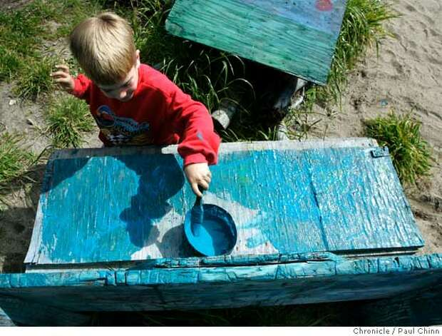 Walter Robards, 6, of San Rafael adds a fresh coat of blue paint to a plywood bench at Adventure Playground in Berkeley, Calif. on Saturday, March 10, 2007. Adventure Playground is a unique location where children can play on structures that they actually create and construct using tools provided to them. The playground�s been around since 1979 but the concept began after WW II in Europe. At the Berkeley park, countless pieces of scrap wood, tires, rope and other material is donated and used again-and-again by the kids to construct and dismantle slides, swings and climbing structures.  PAUL CHINN/The Chronicle  **Walter Robards Photo: PAUL CHINN