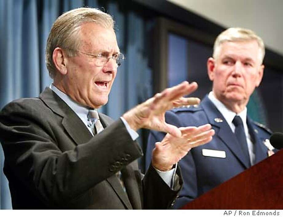 Secretary of Defense Donald H. , left, and Chairman of the Joint Chiefs of Staff, Air Force Gen. Richard B. Myers, right, brief reporters Tuesday, June 23, 2003, during the daily briefing at the Pentagon. (AP Photo/Ron Edmonds) Photo: RON EDMONDS