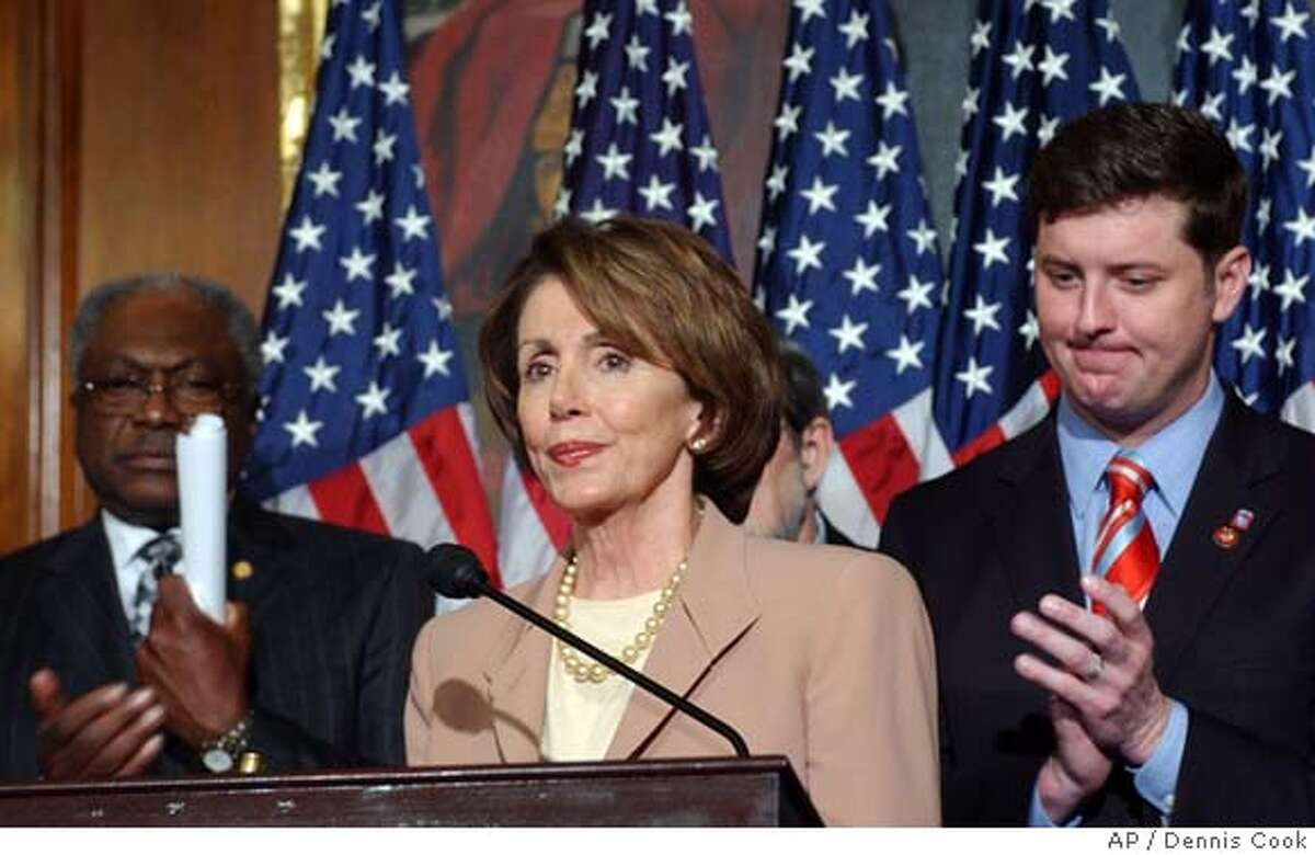 House Speaker Nancy Pelosi of Calif., center, flanked by House Majority Whip James Clyburn of S.C., left, and Rep. Patrick Murphy, D-Pa., meets reporters on Capitol Hill in Washington, Friday, March 23, 2007, after a sharply divided House of Representatives voted to order President Bush to bring combat troops home from Iraq next year. (AP Photo/Dennis Cook)