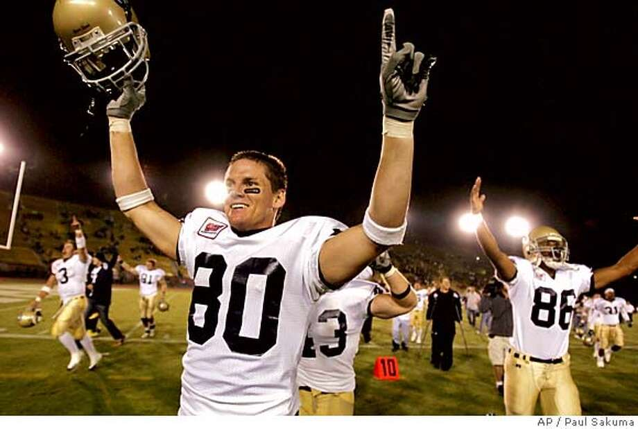 UC Davis wide receiver Blaise Smith celebrates after scoring the winning touchdown in the last minute to give UC Davis a 20-17 win over Stanford, Saturday, Sept. 17, 2005, in Stanford, Calif. (AP Photo/Paul Sakuma) Photo: PAUL SAKUMA