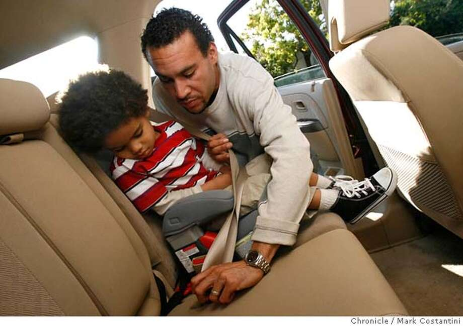 Near His Berkeley Home Anthony Johnson Demonstrates Putting Son Austin Into Carseat