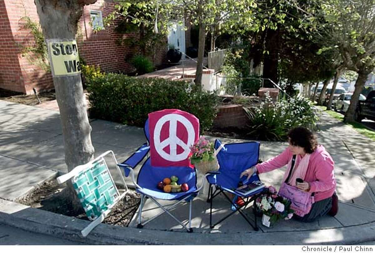 Cynthia Papermaster settles in for a day of protest at House Speaker Nancy Pelosi's Pacific Heights home where anti-war protesters continued their vigil in San Francisco, Calif. on Friday, March 23, 2007. Police moved in Thursday night to sweep out the encampment of tents and other camping gear but allowed the protesters to keep folding chairs on the sidewalk and allowed them to sleep in their cars. PAUL CHINN/The Chronicle **Cynthia Papermaster