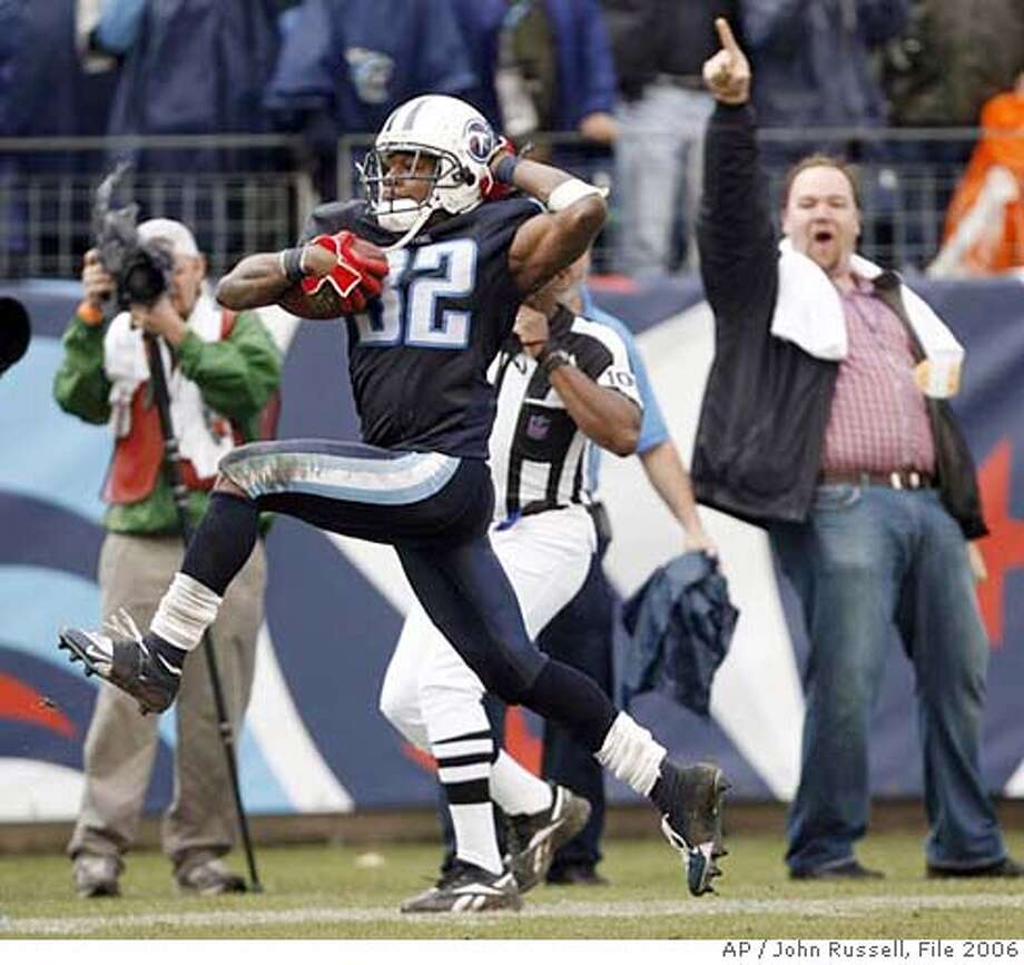 Tennessee Titans punt returner Pacman Jones (32) high-steps into the end zone as he returns a punt 81 yards for a touchdown against the New England Patriots in the second quarter of an NFL football game in Nashville, Tenn., Sunday, Dec. 31, 2006. (AP Photo/John Russell)  Ran on: 01-07-2007  Pacman Jones returned three punts for TDs but also was suspended after a misdemeanor assault charge. Photo: John Russell
