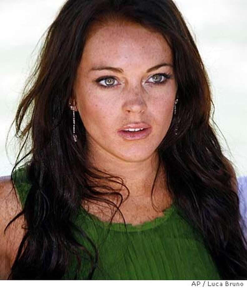 U.S. actress Lindsay Lohan arrives on a boat prior to a press conference to present her movie 'Bobby', by U.S. director Emilio Estevez, at the 63rd edition of the Venice film festival in Venice, Italy, Tuesday, Sept.5, 2006. (AP Photo/Luca Bruno)  Ran on: 09-24-2006  Actress Lindsay Lohan says she wants to live in a house, not a condo. Photo: LUCA BRUNO