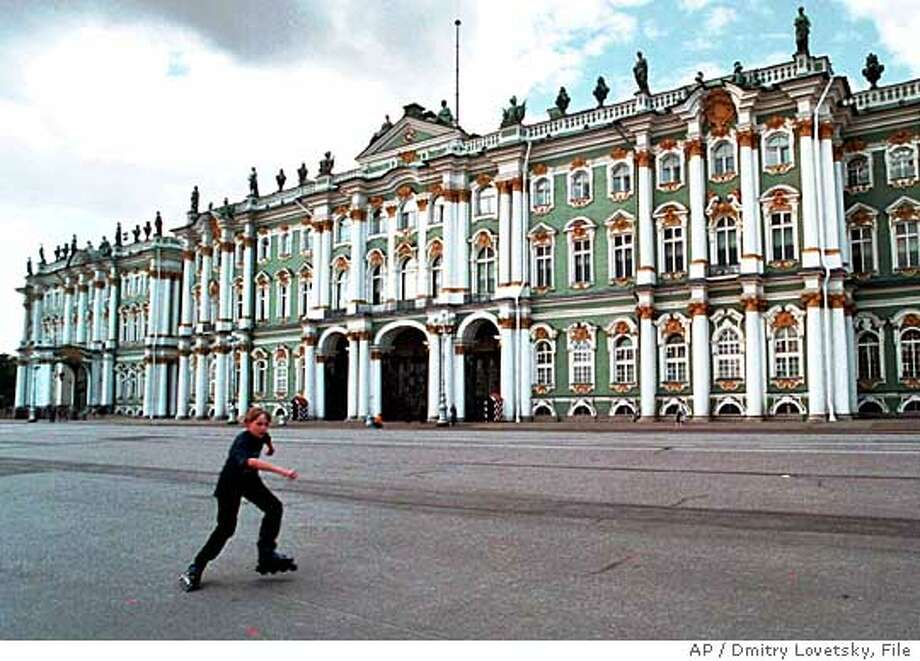 TRAVEL ST. PETERSBURG -- A boy rides in-line skates in front of the Winter Palace in St. Petersburg, Russia, Aug.13, 1998. The Hermitage has a collection of nearly 3 million items in the Romanov's Winter Palace and surrounding Hermitage buildings that date from the 18th and 19th centuries. (AP Photo/Dmitry Lovetsky) Ran on: 09-18-2005  The Hermitage, always a favored destination in Russia's most European city, is developing a cafe scene to match. Photo: DMITRY LOVETSKY