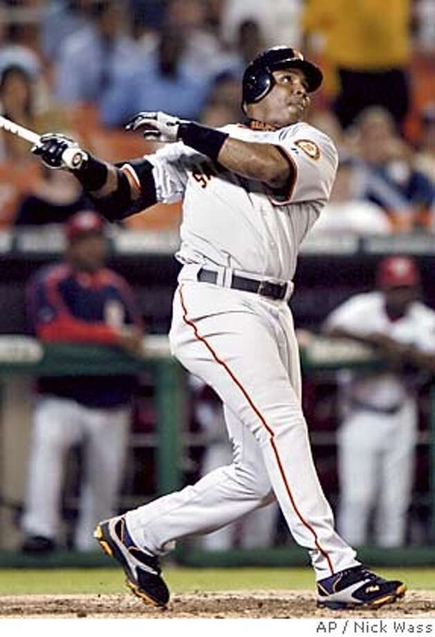 San Francisco Giants' Barry Bonds watches his home run against the Washington Nationals during the fourth inning Tuesday, Sept. 20, 2005, at RFK Stadium in Washington.(AP Photo/Nick Wass) Photo: NICK WASS