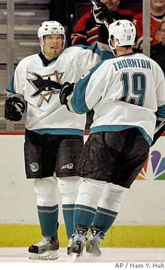San Jose Sharks' Milan Michalek of the Czech Republic, left, celebrates with Joe Thornton after scoring a goal against the Chicago Blackhawks during the second period of an NHL hockey game Wednesday, March 21, 2007, in Chicago.(AP Photo/Nam Y. Huh) Photo: Nam Y. Huh