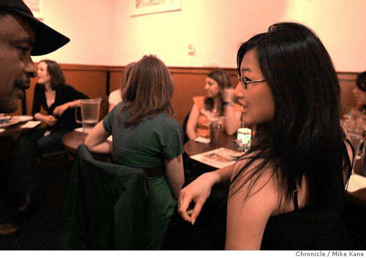 FOODBLOG25_116_MBK.JPG Jennifer Tsang, right, orders a drink at Club Waizema, an Ethiopian restaurant, in San Francisco, CA, on Friday, March, 23, 2007. Tsang researched online with Yelp to decide where to eat out with friends for a birthday celebration. photo taken: 3/23/07 Mike Kane / The Chronicle **Jennifer Tsang MANDATORY CREDIT FOR PHOTOG AND SF CHRONICLE/NO SALES-MAGS OUT