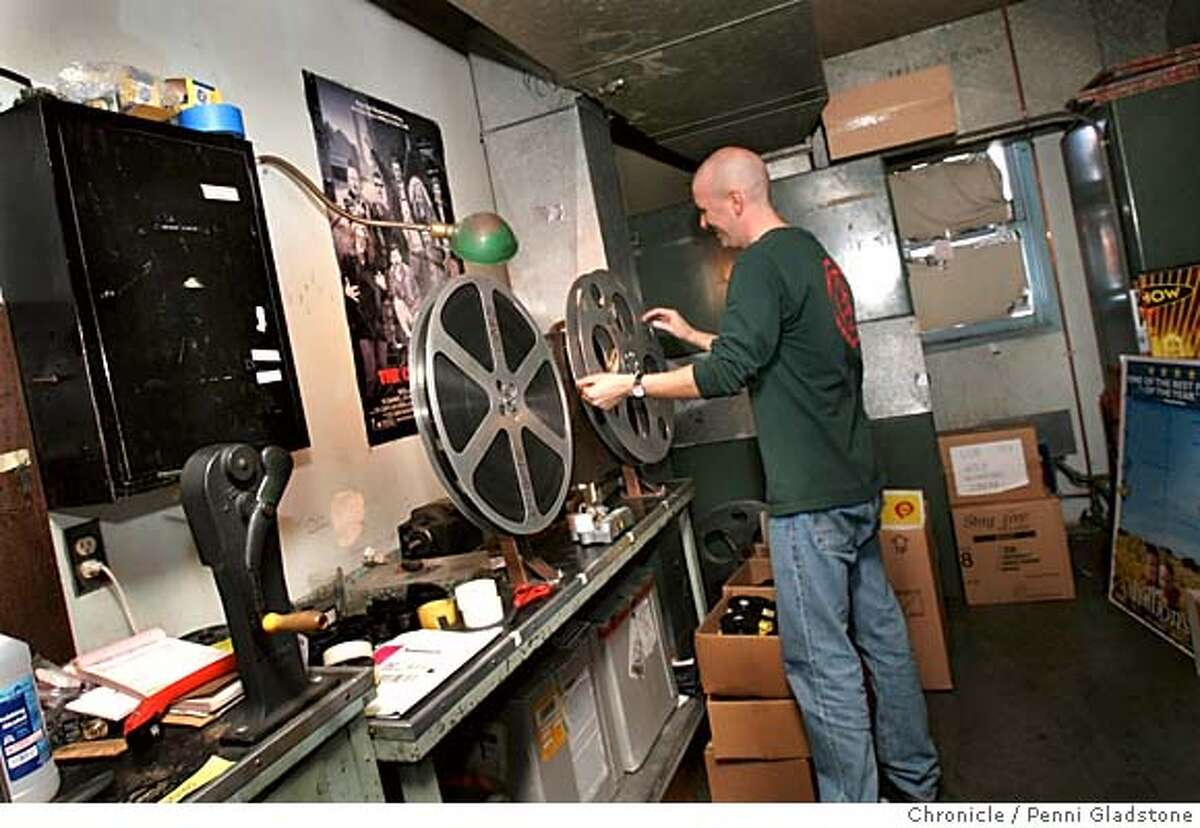 cinema180049_PG.JPG Vince Townsend the mgr of the cinema rolls back the film he had just shown from the projection room. The last picture shows are running this weekend in Lafayette, where the Park Theater is turning out the lights because the owner can no longer compete with suburban megaplexes. San Francisco Chronicle, Penni Gladstone Photo taken on 9/18/05, in Lafayette,