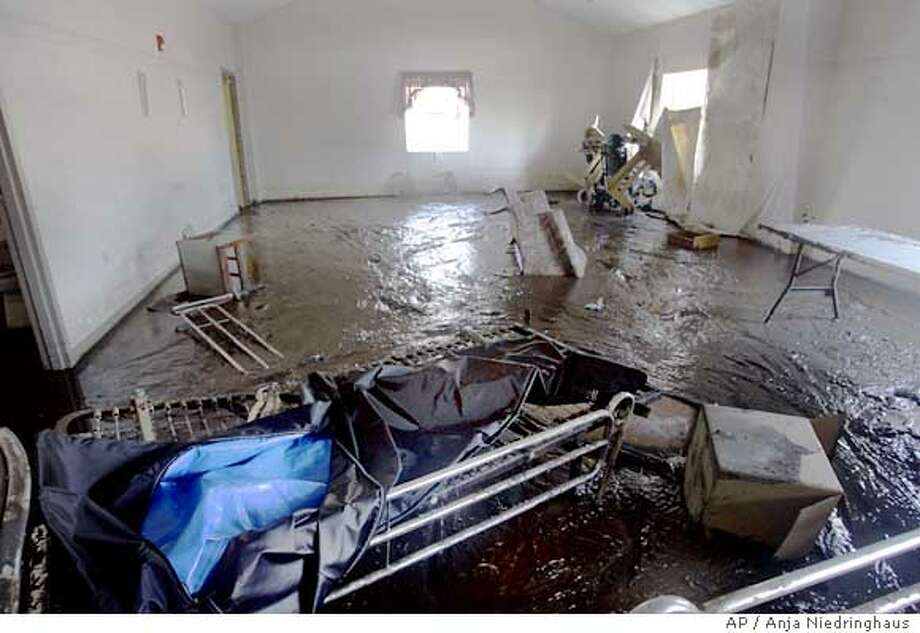 ** CORRECTS BYLINE TO NIEDRINGHAUS ** The entrance of St Rita's Nursing Home shows the damage from Hurricane Katrina in St. Bernard, La., Friday, Sept. 16, 2005. Thirty four people died in the home while waiting to be rescued from the floodwaters. (AP Photo/Anja Niedringhaus) Ran on: 09-19-2005  St. Rita's Nursing Home, where 34 corpses were found floating in the floodwaters of Hurricane Katrina. Photo: ANJA NIEDRINGHAUS
