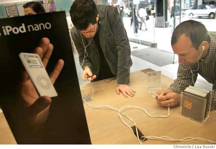 ipod031_ls.JPG from left: Gareth Spor of Berkeley and Mark McKechnie of San Francisco check out Apple Computer Inc.'s new iPod Nano at the Apple store. Apple Computer Inc.'s new iPod Nano is creating a buzz, one that design consultants is indicative of the way the Cupertino company has transcended technology and made the iPod a lifestyle/pop culture product. Shoot people using buying etc the Nano and a tight shot of it from various angles and any signage, advertising, etc. Photo taken on 9/14/05 in San Francisco, CA. Photo by Lea Suzuki/ The San Francisco Chronicle Photo: Lea Suzuki