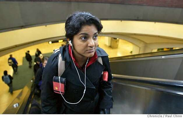 "Ena Ladi, a post-doctorate at Cal, listens to her iPod as she arrives at the Downtown Berkeley BART station in Berkeley, Calif. on Tuesday, March 20, 2007. A spike in iPod thefts around the Bay Area, including several in Berkeley the past few months, has prompted BART officials to post warnings to commuters and police officials to set-up sting operations to nab would-be thieves. Despite the warnings Ladi isn't worried about theft. ""I've got a really old iPod,"" Ladi said.  PAUL CHINN/The Chronicle  **Ena Ladi MANDATORY CREDIT FOR PHOTOGRAPHER AND S.F. CHRONICLE/NO SALES - MAGS OUT Photo: PAUL CHINN"
