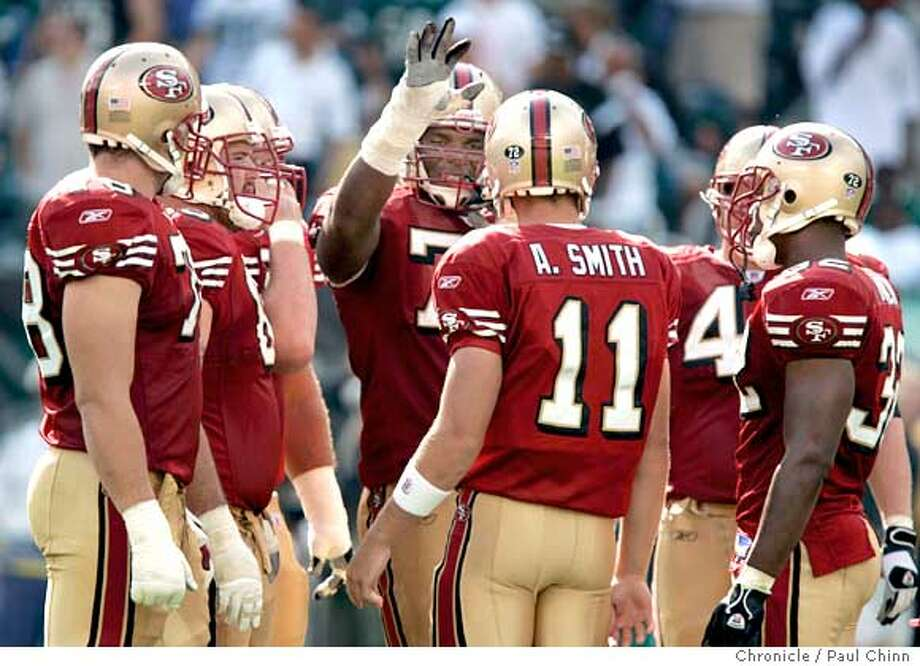 Tackle Kwame Harris (center) welcomed Alex Smith to the huddle when the rookie QB made his NFL debut in the fourth quarter of the San Francisco 49ers vs. Philadelphia Eagles at Lincoln Financial Field on 9/18/05 in Philadelphia, Pa. The Eagles beat the 49ers 42-3.  PAUL CHINN/The Chronicle Photo: PAUL CHINN