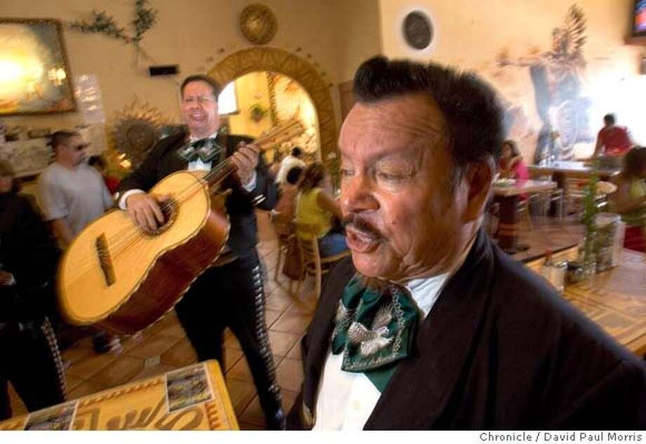 OAKLAND, CA. AUGUST 2005: Members of the Mariachi Alma De America play for people in El Huarache Azteca in Oakland, California. Photo by David Paul Morris the Chronicle Photo: David Paul Morris