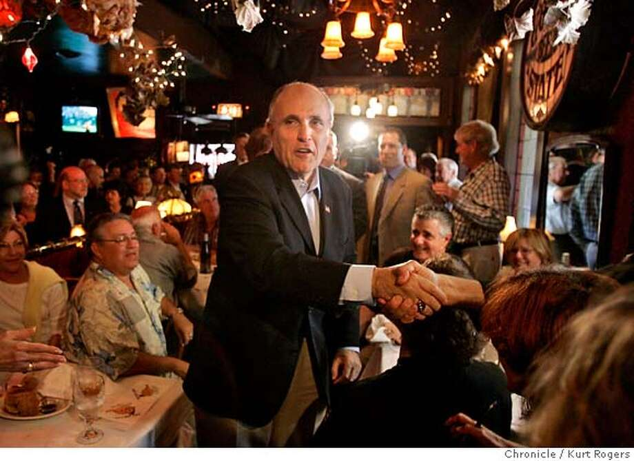 Former New York Mayor Rudy Giuliani made a pass through the Fat Lady Restaurant in Jack london Square . there was a small group of people on hand to greet him.  FRIDAY, MARCH 23, 2007 KURT ROGERS/THE CHRONICLE OAKLAND THE CHRONICLE  KURT ROGERS/THE CHRONICLE GIULIANI_0019_kr.jpg Photo: KURT ROGERS/THE CHRONICLE