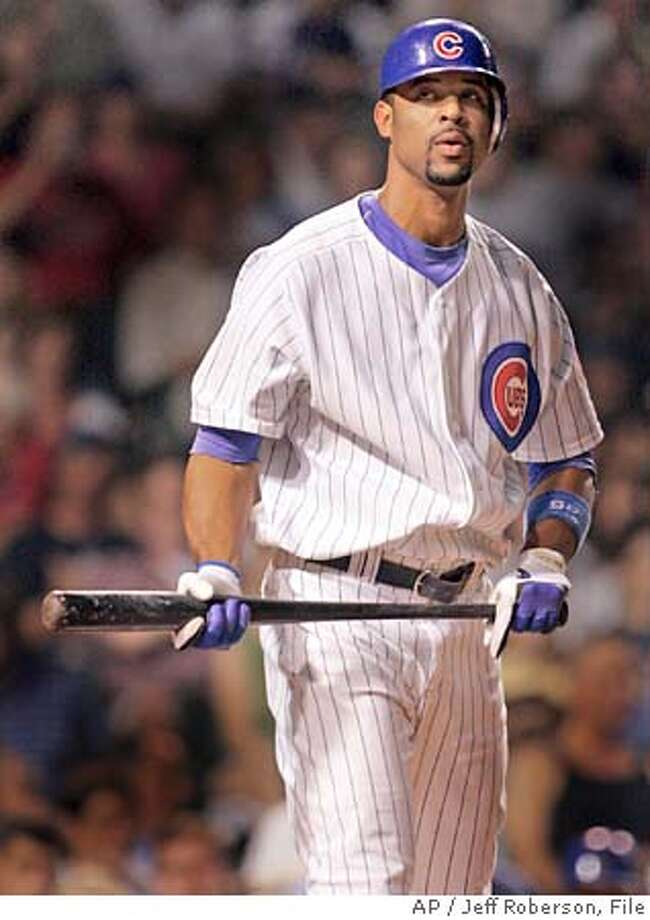 Chicago Cubs' Derrek Lee stands alone in the batters' box after striking out swinging to end the eighth inning against the Cincinnati Reds Monday, Sept. 12, 2005 in Chicago. Lee went 0-4 in the Cubs' 5-2 loss. (AP Photo/Jeff Roberson) Photo: JEFF ROBERSON