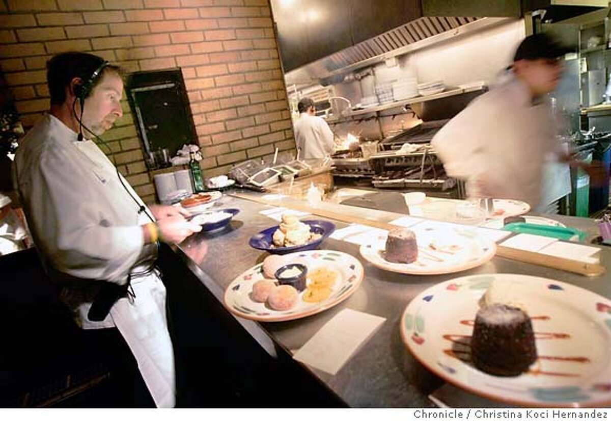 Executive chef, John Henningan, keepd a watchful eye on plates leaving the kitchen.The restaurant, LuLu, has been updated, by opening the kitchen to the dining room.(Christina Koci Hernandez/The Chronicle) CHRONICLE Photos by Christina Koci Hernandez