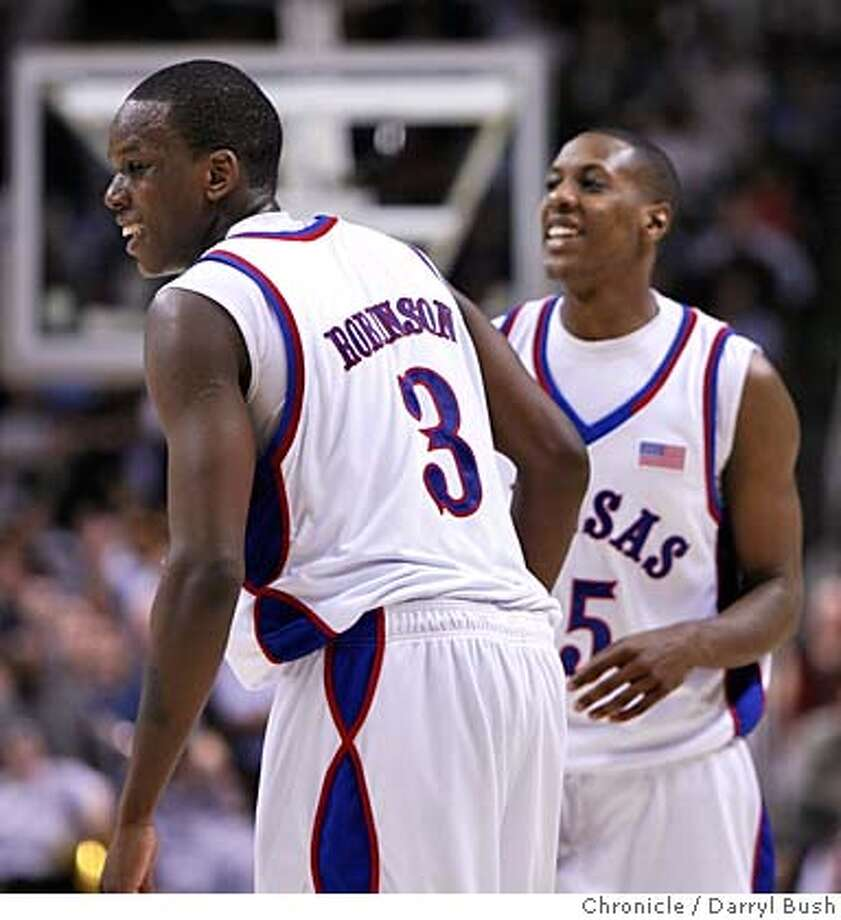 ncaawestsemi_1_0019_db.JPG  Kansas' Russell Robinson (3) and Mario Chalmers (15), back, laugh at the end of the game defeating Southern Illinois, Southern Illinois vs. Kansas for the NCAA West Regional semifinal game at HP Pavilion in San Jose, CA, on Thursday, March, 22, 2007. Kansas defeats S. Illinois. photo taken: 3/22/07  Darryl Bush / The Chronicle ** roster (cq) Photo: Darryl Bush