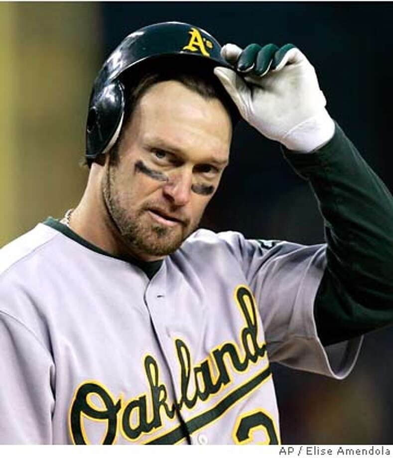 Oakland Athletics' Mark Kotsay takes off his helmet after striking out in the seventh inning leaving one man on in Game 4 of the American League Championship Series in Detroit, Saturday, Oct. 14, 2006. (AP Photo/Elise Amendola)  Ran on: 10-17-2006 Ran on: 10-17-2006 Photo: Elise Amendola