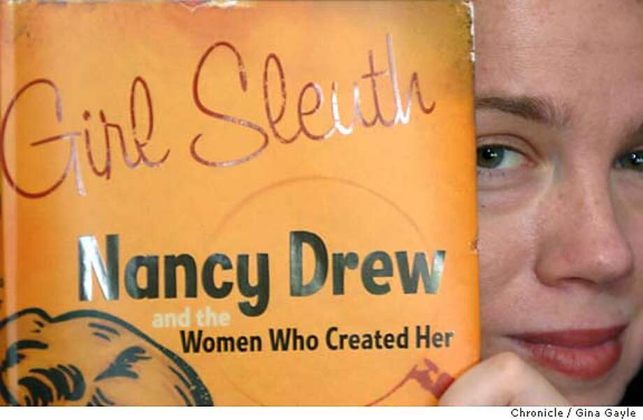 """Author Melanie Rehak, who loved Nancy Drew mysteries when she was a kid, sits in her Brooklyn, NY home surrounded by books and music on Thursday, August 18, 2005. When Melanie became an adult, her love of the """"titan-haired"""" sleuth inspired her to investigate the true-life mystery of Nancy Drew's creators: the male book mogul who invented Nancy, and the two different women who brought her to life on the page. Melanie Rehak wrote """"Girl Sleuth"""" which tells the story of Nancy Drew's inventors and tells the story as well of the plucky detective's role in modern American culture. (Photo/Gina Gayle)  SLUG: Photo: GINA GAYLE"""