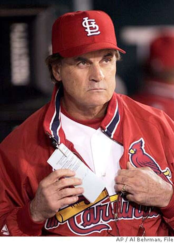 St. Louis Cardinals manager Tony LaRussa watches the action in the firth inning during Game 1 of the National League Championship Series against the Houston Astros Wednesday, Oct. 13, 2004, in St. Louis. (AP Photo/Al Behrman) Ran on: 10-14-2004  Cardinals manager Tony La Russa is in his ninth League Championship Series. ALSO Ran on: 01-09-2005 Tony La Russa could match Red Schoendienst as second longest Cardinals manager -- 12 years -- if his contract runs its course. Ran on: 04-07-2005  FERC Chairman Patrick Wood Ran on: 04-07-2005  FERC Chairman Patrick Wood Ran on: 08-12-2005  Tony LaRussa is the main figure in a &quo;Costas Now&quo; segment tonight on HBO. Photo: AL BEHRMAN