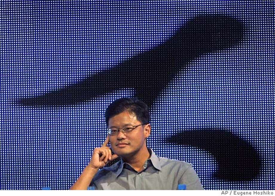 Jerry Yang, co-founder of Yahoo! listens questions from audience at the China Internet Summit Saturday Sept. 10, 2005 in Hangzhou, China. Yahoo had to comply with a demand by Chinese authorities to provide information about a personal e-mail of a journalist who was later convicted under state secrecy laws and sentenced to 10 years in prison, the company's co-founder Jerry Yang said Saturday. (AP Photo/Eugene Hoshiko) Photo: EUGENE HOSHIKO