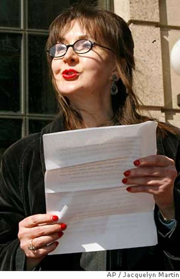 Deborah Palfrey of Vallejo, Calif., reads a statement outside federal court in Washington on Friday, March 9, 2007, after her arraignment on federal racketeering charges. Palfrey, accused of running an illegal escort service in the nation's capital, has 46 pounds of phone records. And her offer _ or threat _ to turn them over to the media has some in Washington playing a guessing game as to whether any Beltway movers and shakers are on her list of up to 15,000 client phone numbers. (AP Photo/Jacquelyn Martin) Photo: Jacquelyn Martin