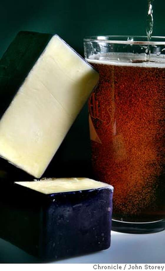 Cabot Vintage Cheddar with beer. John Storey San Francisco Event on 9/1/05  - Photo: John Storey