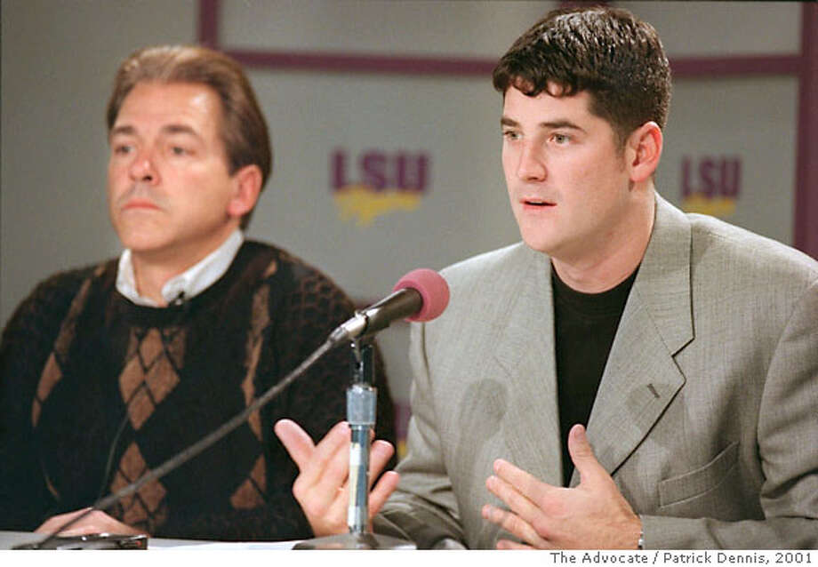 Louisiana State quarterback Josh Booty, right, speaks during a news conference, Thursday, Jan. 11, 2001, on campus in Baton Rouge, La. where he announced he is skipping his senior season to enter the NFL draft. At left is LSU head football coach Nick Saban. (AP PHOTO/PATRICK DENNIS) Photo: PATRICK DENNIS
