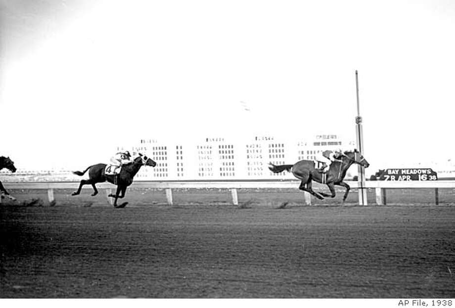 Seabiscuit leads to victory over Gosum in the $15,000 Bay Meadows Handicap in San Mateo, Ca. on April 16, 1938. Seabiscuit set a new track record with 1:49. (AP Photo)