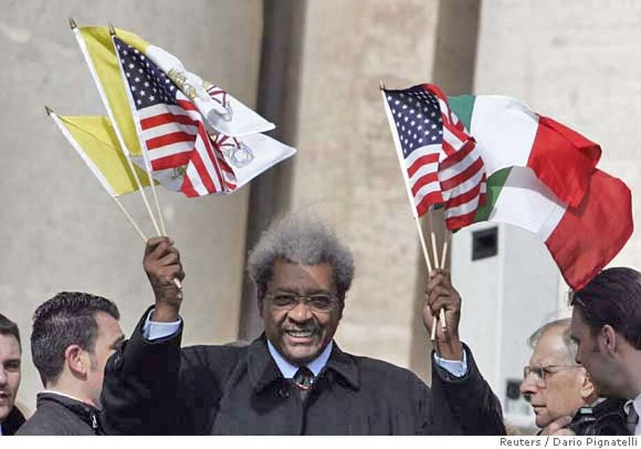 U.S. boxing promoter Don King waves flags during Pope Benedict XVI's weekly general audience in Saint Peter's Square at the Vatican March 21, 2007. REUTERS/Dario Pignatelli (VATICAN) 0 Photo: STRINGER/ITALY