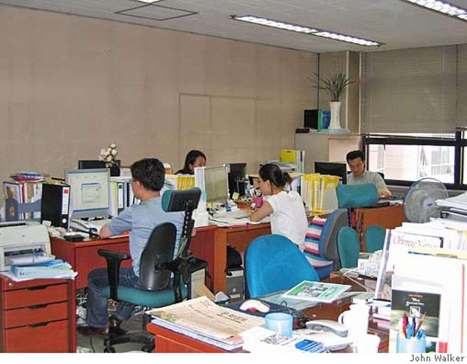 """""""Newsroom of OhmyNews in downtown Seoul"""" on 7/22/05 in . John Walker / HO Photo: John Walker"""