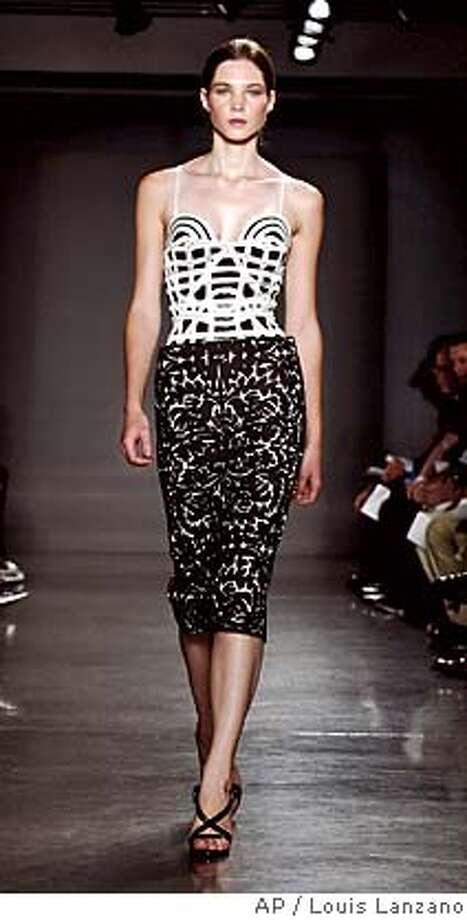 A model wears a black and white embroidered bustier and skirt during the presentation of the Proenza Schouler spring 2006 collection in New York Monday, Sept. 12, 2005. (AP Photo/Louis Lanzano) Photo: LOUIS LANZANO