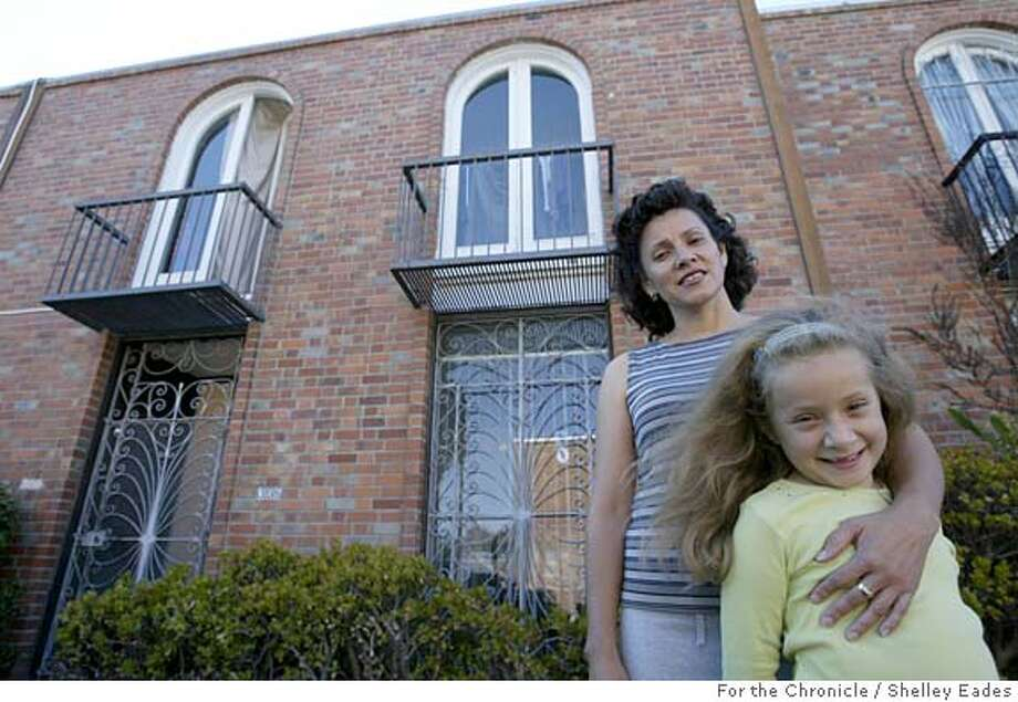 EARN029se.JPG On 8/31/05 in San Francisco. Honduran immigrant Cesilia Bueso pictured in front of her home with six-year-old daughter Paula, was able to buy a house with money she saved and help from Earn, a program that matches the savings of low income folks to buy a home, start a business, or get further education Chronicle Photo by Shelley Eades Photo: Shelley Eades