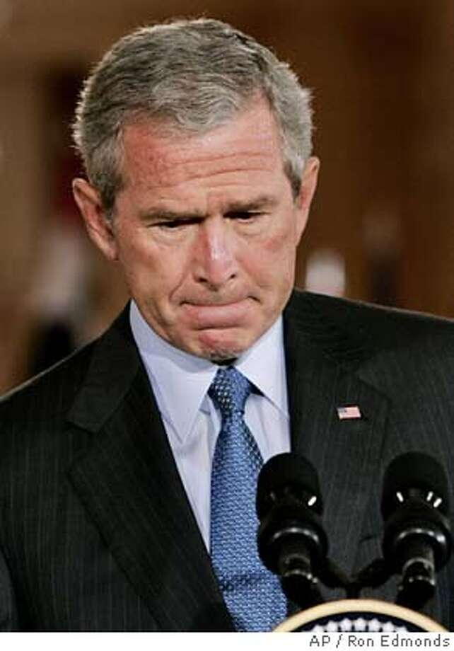 "President Bush reacts during a joint press availiblity with Iraqi President Jalal Talabani, Tuesday, Sept. 13, 2005, in the East Room at the White House in Washington. Bush said Tuesday that ""I take responsibility"" for failures in dealing with Hurricane Katrina and said the disaster raised broader questions about the government's ability to respond to natural disasters as well as terror attacks. (AP Photo/Ron Edmonds) Photo: RON EDMONDS"