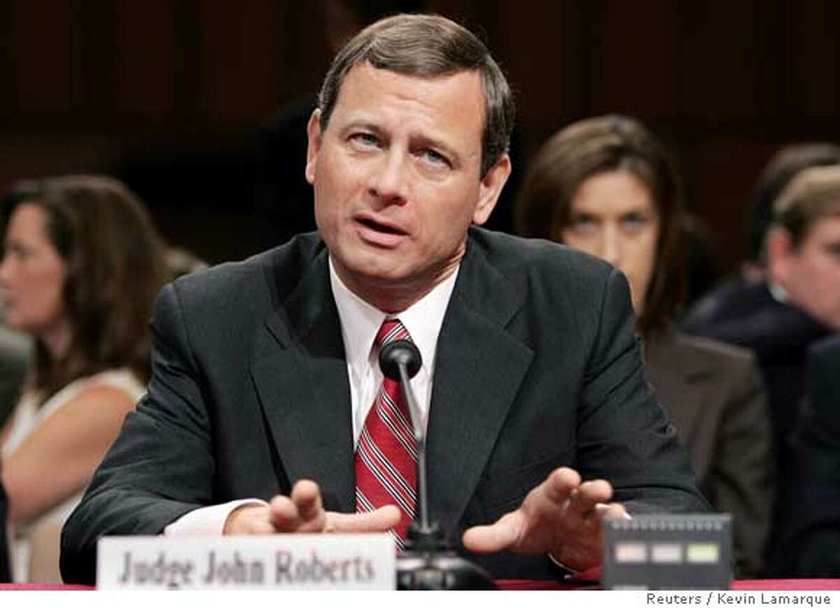 Judge John Roberts answers questions from Senators on the second day of his Supreme Court confirmation hearings before the U.S. Senate Judiciary Committee on Capitol Hill in Washington September 13, 2005. Roberts, recently nominated by President George W. Bush to succeed the late William Rehnquist as Chief Justice of the U.S., was pressed by senators for his views on the strength of established legal precedent with regard to the controversial issue of abortion rights and the landmark Roe vs. Wade abortion case. REUTERS/Kevin Lamarque