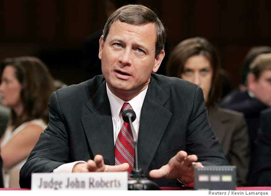 Judge John Roberts answers questions from Senators on the second day of his Supreme Court confirmation hearings before the U.S. Senate Judiciary Committee on Capitol Hill in Washington September 13, 2005. Roberts, recently nominated by President George W. Bush to succeed the late William Rehnquist as Chief Justice of the U.S., was pressed by senators for his views on the strength of established legal precedent with regard to the controversial issue of abortion rights and the landmark Roe vs. Wade abortion case. REUTERS/Kevin Lamarque Photo: KEVIN LAMARQUE