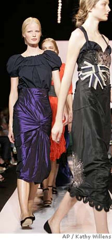 Vera Wang's models strut down the runway at the conclusion of the presentation of her spring 2006 collection Thursday, Sept. 15, 2005, in New York. (AP Photo/Kathy Willens) Photo: KATHY WILLENS