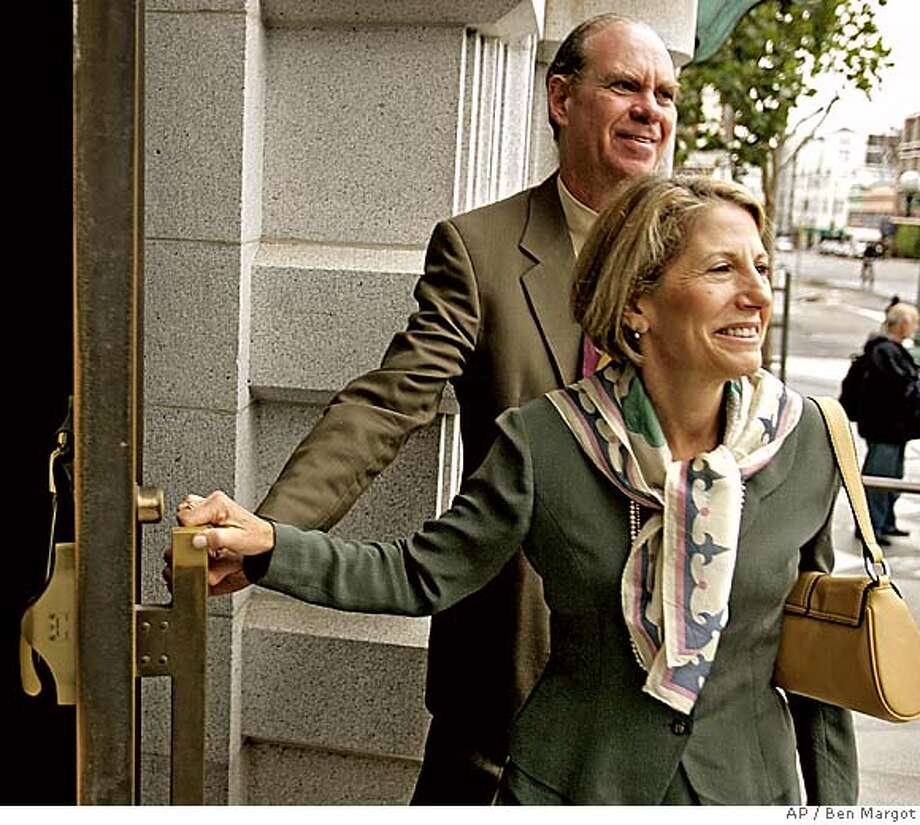 Ed Rosenthal enters a courthouse behind his wife Jane Klein Tuesday, Sept. 13, 2005 in San Francisco. Attorneys for Rosenthal, the pot guru who has written books on how to grow marijuana and avoid getting caught, asked a federal appeals court here Tuesday to overturn his drug convictions. Rosenthal, convicted two years ago of growing and distributing hundreds of marijuana plants, says he was authorized to do so under a 1996 California medical marijuana law. U.S. District Judge Charles Breyer refused to allow a jury to hear that defense, and Rosenthal was prosecuted as a major drug supplier. (AP Photo/Ben Margot) Photo: BEN MARGOT