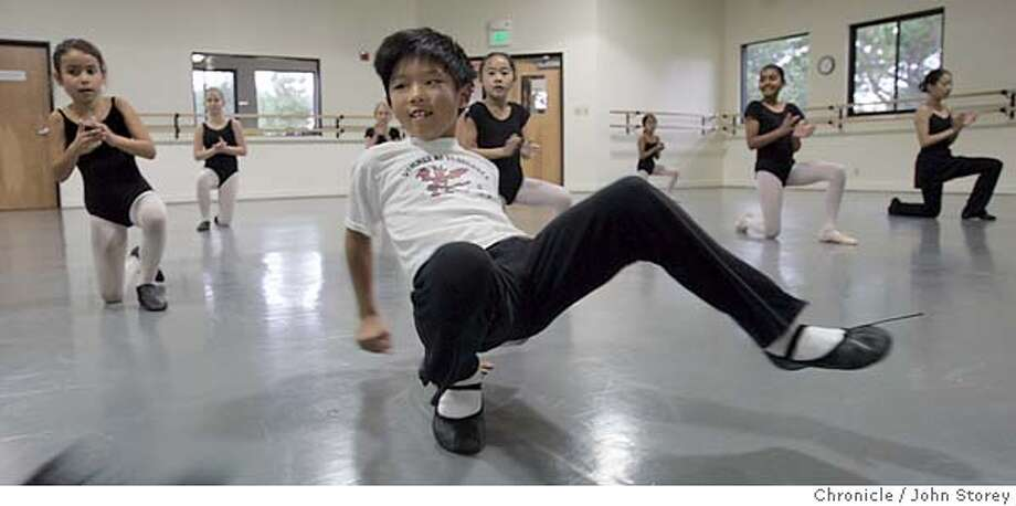 Madhot_jrs_0063.jpg  Ryan Chan dances in front of the class. Kids learn Folk Dancing at the Presidio Dance Theater.  John Storey San Francisco Event on 9/9/05 MANDATORY CREDIT FOR PHOTOG AND SF CHRONICLE/ -MAGS OUT Photo: John Storey