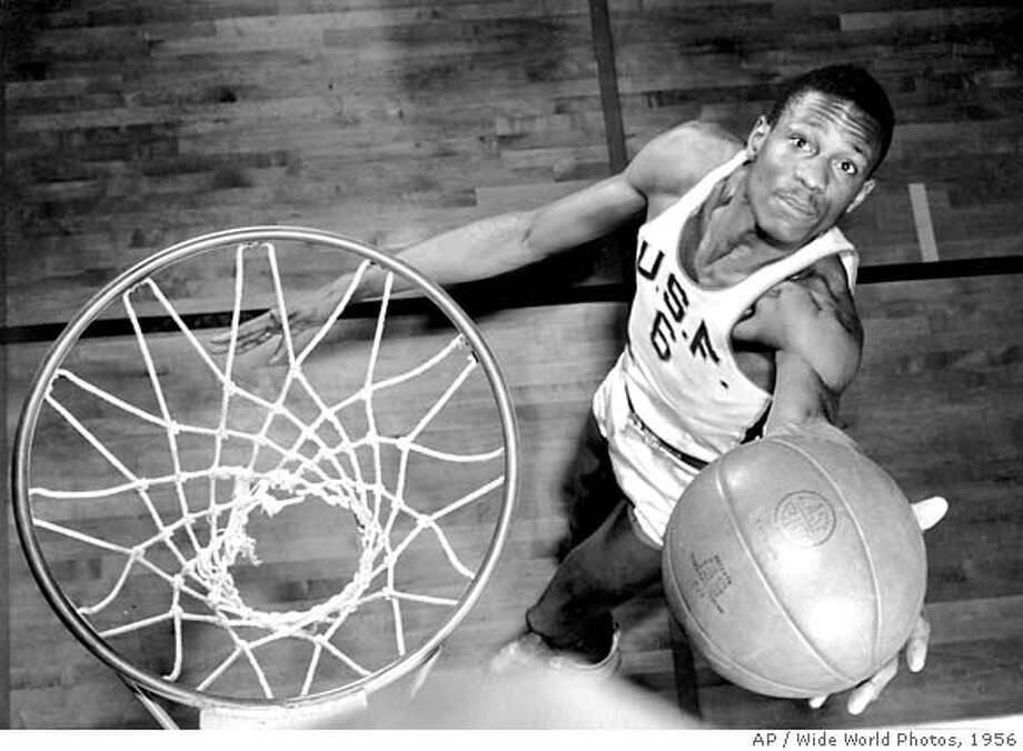 "The Oakland Museum of California's ""Sports: Breaking Records, Breaking Barriers"" highlights 35 history-making athletes who changed the world of sports including William (Bill) Russell, pictured here in an image taken in 1956 at USF. The exhibit runs through Jan. 7. Photo Credit: AP/Wide World Photos. Ran on: 10-01-2006  Take a San Francisco Duck Tour, a land and sea adventure on one of Bay Quackers' original, refurbished World War II amphibious landing craft.  ALSO Ran on: 12-17-2006  Bill Russell, shown here in 1956 at the University of San Francisco, made his professional basketball debut with the Boston Celtics in December of that year. Photo: AP/Wide World Photos"