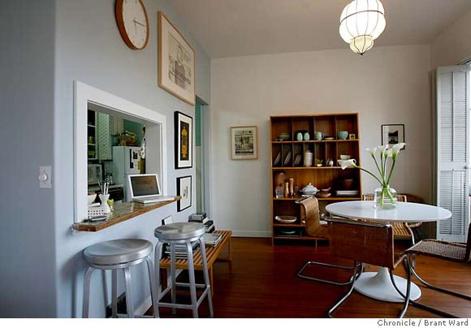 .JPG  The dining area of Victoria Smith's apartment features natural light and many discoveries from flea markets over the years.  Victoria Smith, a San Francisco advertising exec, has furnished much of her Pacific Heights home with articles picked up at flea markets, etc. She most recently attended the huge antique faire held in Alameda.  {Brant Ward/San Francisco Chronicle}3/8/07 Photo: Brant Ward